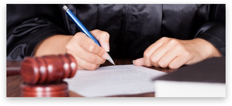 Judge signing a paper